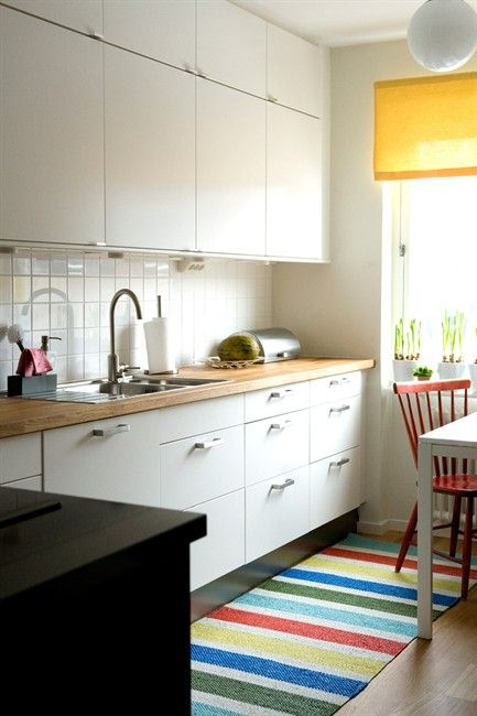 Create some variation on your cupboards. Use small handles on wall units and larger grab handles on base cabinets