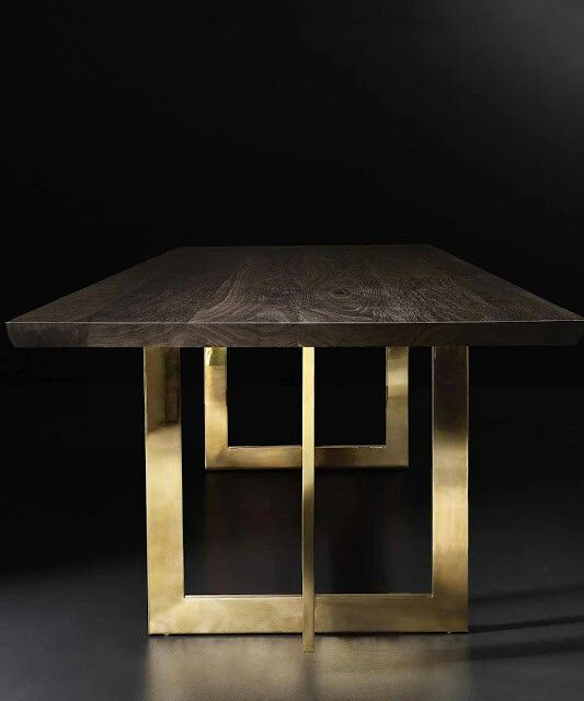 RH MODERN's Wythe Live Edge dining table with brass legs.