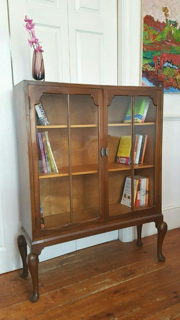 Vintage 1930's art deco walnut bookcase. Lovely queen Anne legs and chrome handles. Can deliver