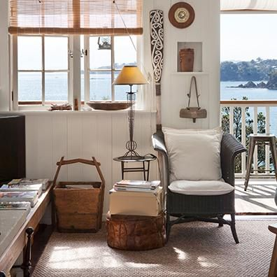 Island Living. Baz and Kate Hasting's cliff-top home overlooks the ocean on Waiheke island. Designer Anna Desbonnets helped Kate to select a sisal rug in Malaga for the living room. The natural rug compliments the interior, which has a nautical feel – and is filled with art and exotic objects.