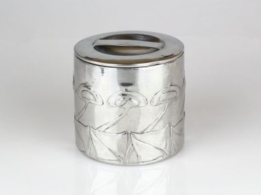Liberty & Co Tudric pewter tobacco pot.  Designed by Archibald Knox C1902-1904, with stylised flower decoration. In very good overall condition with well defined pattern. The lid has a couple of small dings,on the edge which can be seen in the photographs. Marked to base.  9 TUDRIC 0193