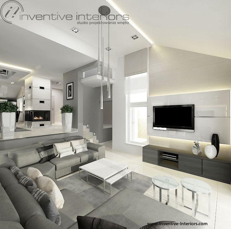 Projekt salonu Inventive Interiors - pomysł na oświetlenie i ściany w wysokim dwupoziomowym salonie