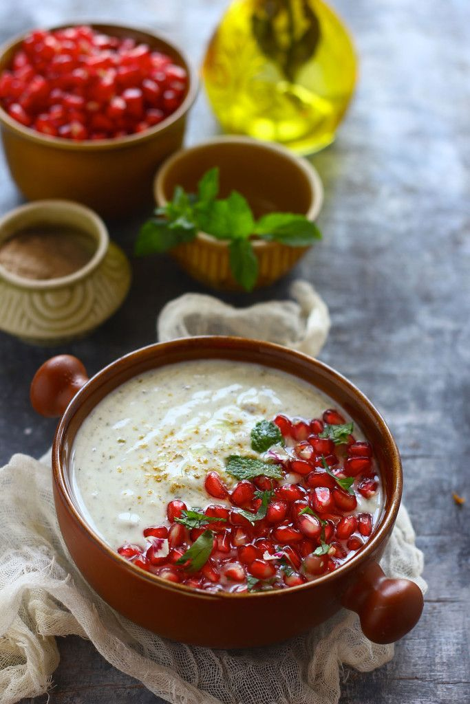 Mint and Pomegranate Raita is a delicious combination of mint, coriander, and pomegranate pearls. Perfect summer grub. funfoodfrolic.com