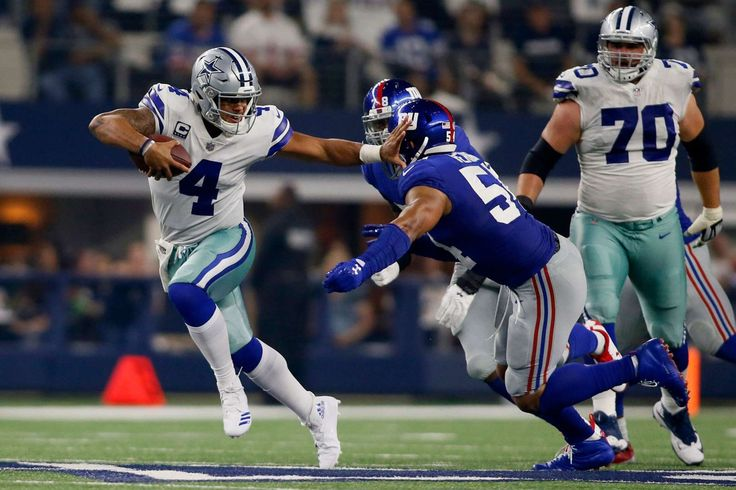 Dallas Cowboys quarterback Dak Prescott (4) breaks a tackled by New York Giants defensive end Romeo ... - Tim Heitman, USA TODAY Sports