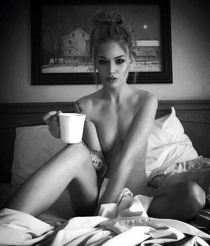This excellent naked woman drinking morning coffee