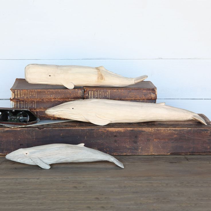 """Made of pine wood, the carved wood whale mystifies with its perplexing stare, making it an affectionate inhabitant of any home. - Dimensions: 2.5""""W x 14.5""""L x 3""""H - Color: Natural - Material: Wood - S"""