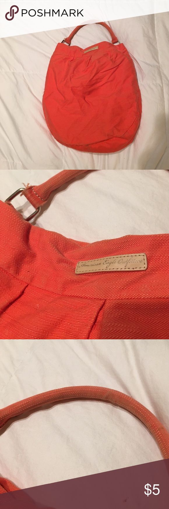 """American Eagle tote purse Orange American Eagle tore or purse. Has definite ware including pulling, inside has pen stains, and handle being dirty. Have not tried washing it. Inside has zipper and two small pockets. Closure is magnetic. Perfect pool bag. Size is approximate because it's not a symmetrical perfectly shaped bag. Opening is about 9""""L and as wide as 10"""" opening. American Eagle Outfitters Bags Totes"""