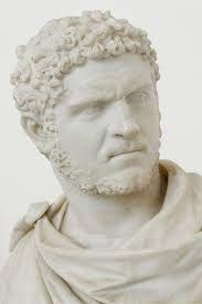 Ritratto di Caracalla; III secolo d.C.; ritratto a tutto tondo in marmo; conservato ai Musei Vaticani.  Il volto dell'imperatore è privo di idealizzazione, i lineamenti disegnati con tratti grafici e veloci, gli occhi disegnati con il trapano, piatti.
