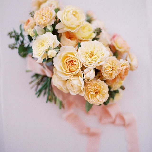 gorgeous all garden rose bridal bouquet with peach and yellow roses.
