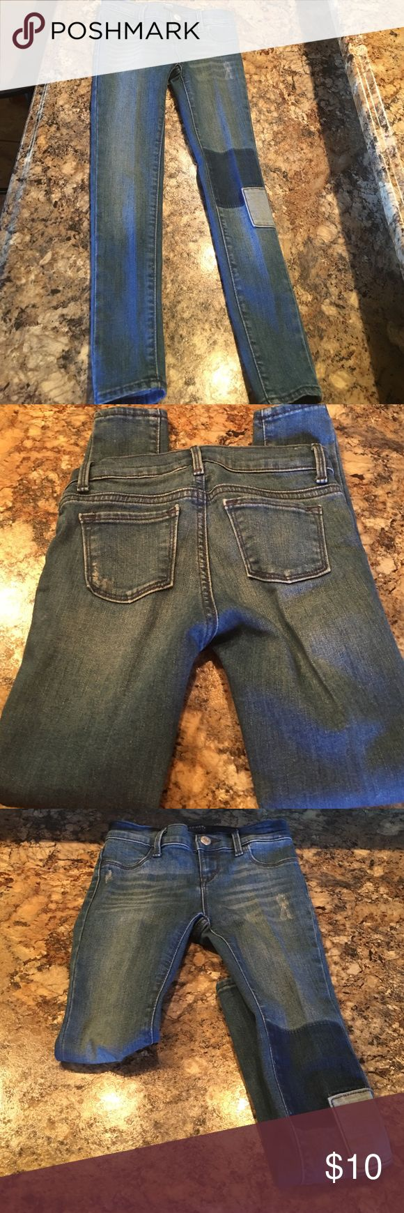 Girls rockstar jeggins Girls size 7 old navy's rockstar jeggins. Jeggins have a patch work design on left leg also have a distress look as well. Jeggins have snap fastener and belt loops as well as pockets. Have been worn but in good condition Old Navy Bottoms Jeans