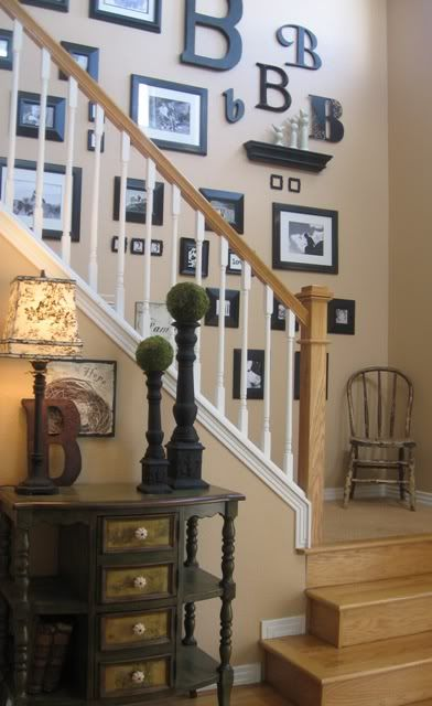 Staircase photo collage wall