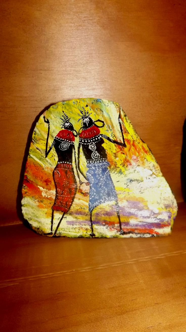 African collection of painted rocks on https://www.facebook.com/pages/The-Stunner-Boutique/456809484484281