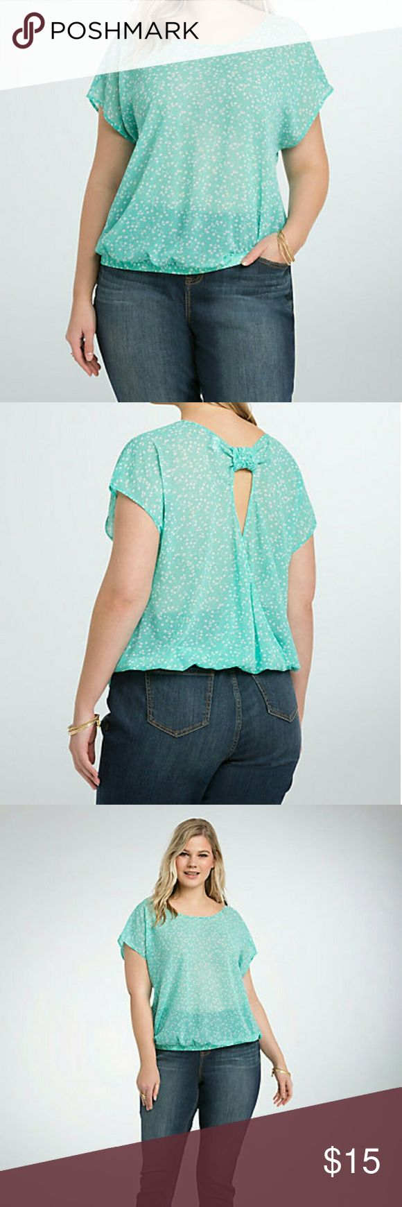 """Floral Chiffon Bow Back Top Want to improve your #currentmood? Sport this sheer mint green chiffon top; it's paired with a playful floral print. The open back is held in place by an adorable bow, the cutout revealing a sliver of skin. A banded bottom lends dramatic definition.     Model is 5'9, size 1      Size 1 measures 28 1/4"""" from shoulder     Polyester     Wash cold, dry low     Imported plus size top torrid Tops"""