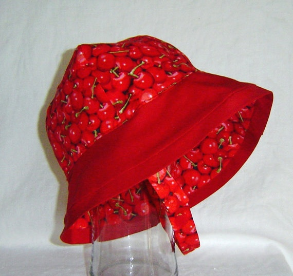 Childs beach hat summer hat sunhat red cherries on red. $21.50, via Etsy.