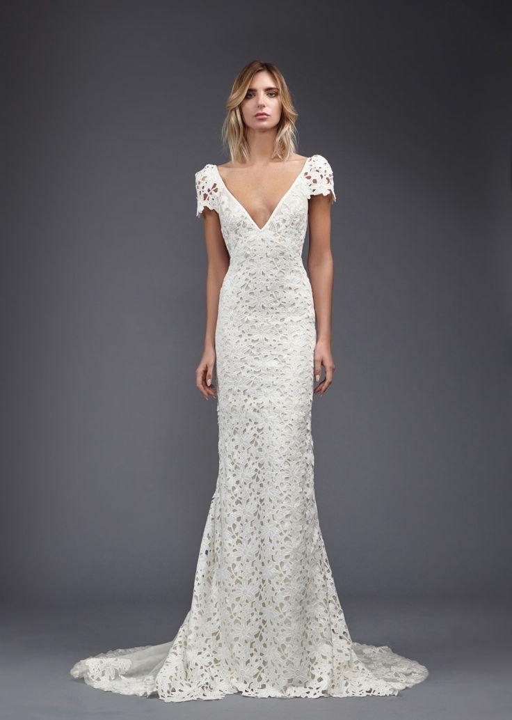 Victoria Kyriakides: http://www.stylemepretty.com/2016/05/06/spring-2017-bohemian-wedding-dress/