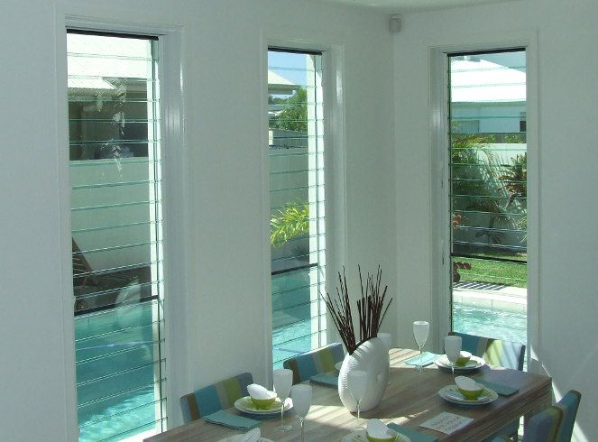 These are the size of the windows in the loungeroom. Plain glass then sliding louvres in front. Yes!