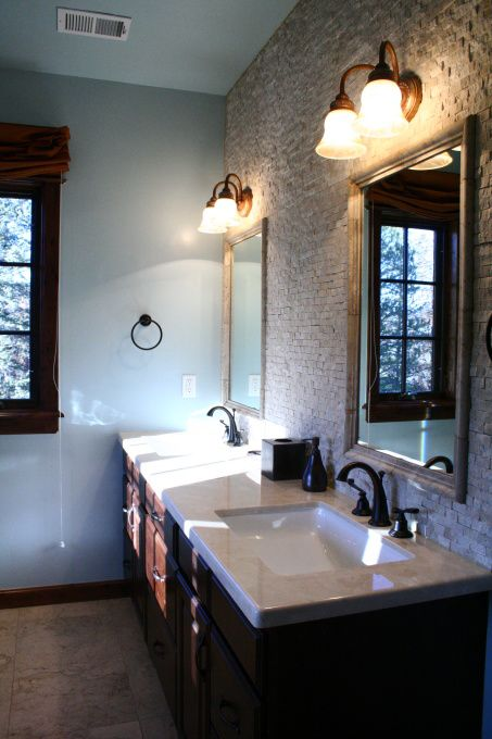 Master bath idea. love the tile wall behind the mirrors. makes a statement.