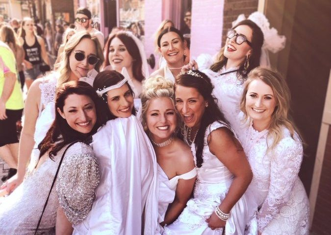 Nashville Bachelorette Party Hits The Town In Goodwill Wedding Dresses Have The Night Of Their Life Bachelorette Party Dress Nashville Bachelorette Nashville Bachelorette Party
