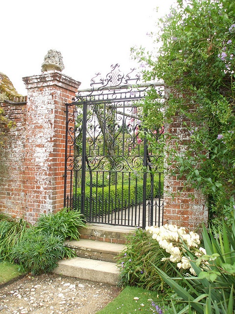 Brick columns with iron gate.