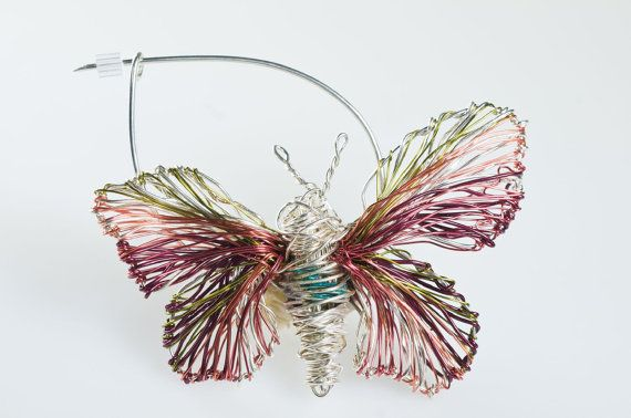 #Pink #Butterfly #broochpin #Butterflyart #jewel #Insectbrooch #Wiresculptureart jewelry  #Insect jewelry This pink butterfly brooch pin, butterfly art jewelry made of colored copper and silver wire.The height of the butterfly wire unusual jewelry insect brooch is 4cm and the width of the wire sculpture insect (body with wings) is 6.5cm.The pin is handmade silver.