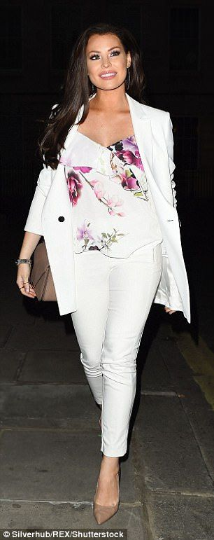 Blooming lovely!The former TOWIE star teamed the tapered trousers and blazer with a floral top and donned a pair of nude heels