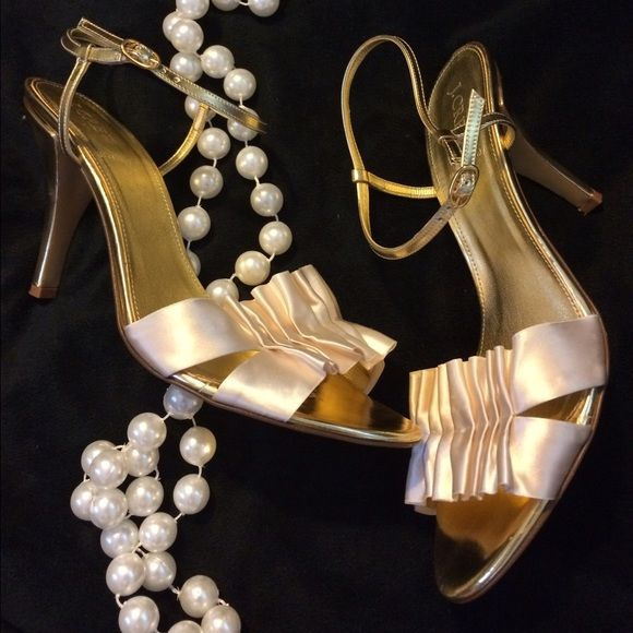 j crew gold and cream strappy heels party shoes Gorgeous and unique j crew gold strappy heels with cream colored, Ruffled satin details. Perfect for news years, holiday party, or a wedding! Size 9.5 and true to size, with adjustable hook straps. Approximately 3 inch heel in great condition. J. Crew Shoes Heels