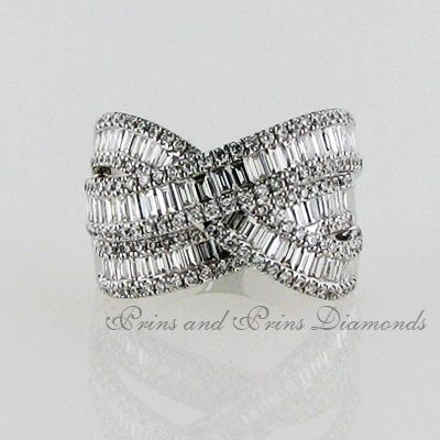 There are 197 = 2.30ct round and baguette cut diamonds pavé and channel set in 18k white gold