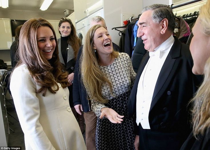 Sharing a joke: The Duchess bursts into laughter during a chat with actor Jim Carter who p...