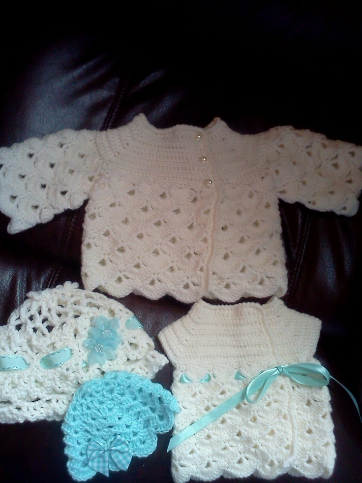 Crocheted baby sweaters with matching hats