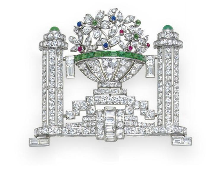 AN ART DECO DIAMOND AND MULTI-GEM BROOCH