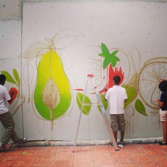 Students working on mural for school garden