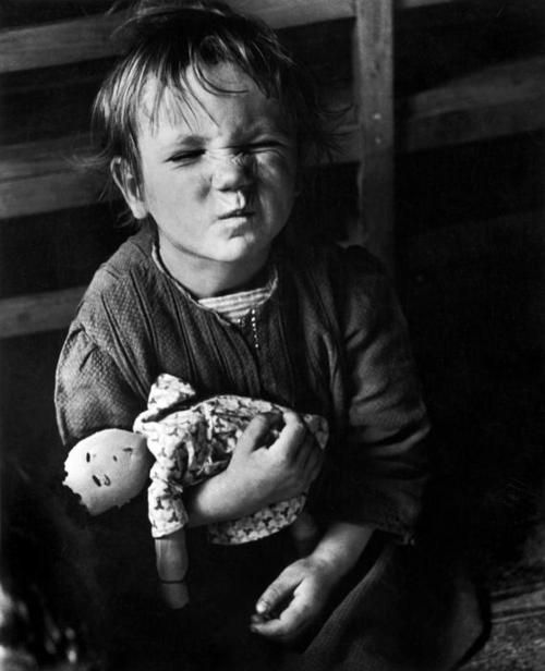 Vienna. 1948. Child with a homemade doll. Displaced Persons Camp from the Sudeten land, an old arsenal, half-destroyed, which was given to the displaced persons.    © David Seymour