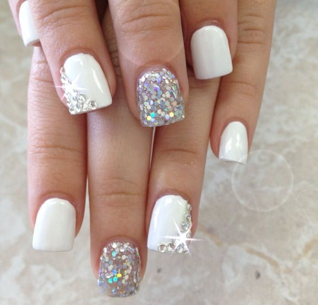 Beautiful white gel nails with rhinestones and glitter