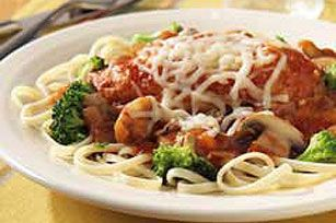 Chicken Parmesan with Linguine and Broccoli recipe,Parmesan-coated chicken breasts are browned then simmered in a flavorful tomato sauce, sprinkled with mozzarella and served over pasta and broccoli.