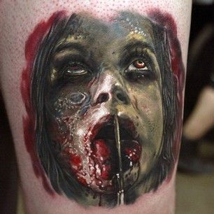 Evil Dead was freaky enough as a movie. | The 31 Creepiest Tattoos To Ever Happen