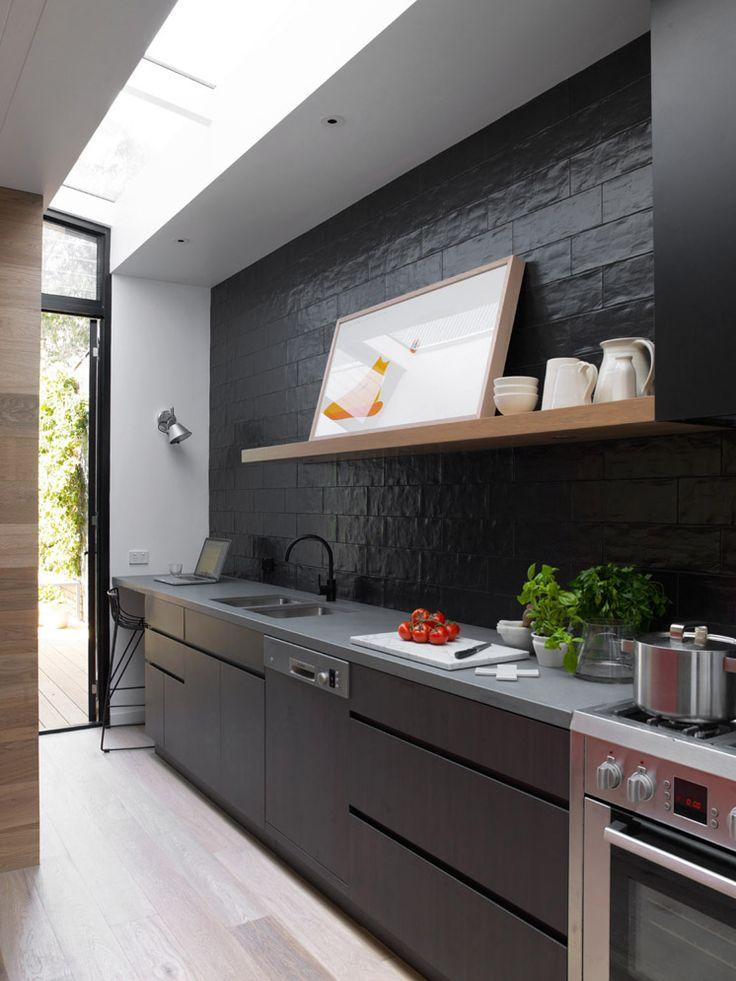 Sanders & King St Kilda 38 | Est Magazine Kitchen cupboard fronts | LAMINEX black and 'Burnished wood' laminates Kitchen Benchtop | STONE ITALIANA 'Jaipur' colour Thyme Kitchen Tiles to splash back | ONSITE Obsis matt black tiles