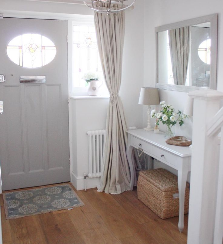 Bright and neutral hallway with 1930's door