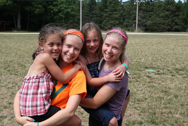 Hugs with friends at YMCA Day Camp