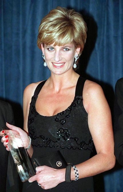 Eurowoman December 1995 - Still wearing her famous engagement ring with co-ordinating sapphire and diamond cuffs,Diana attending the Humanitarian of the Year Award gala in New York wearing a black beaded gown by Jacques Azagury.