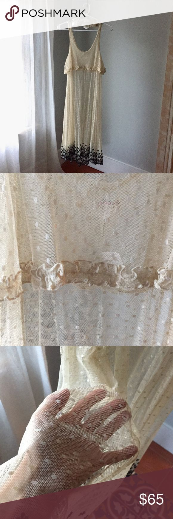 """Lovely Free People sheer lace dot dress Sheer ivory with gentle ruffle detail below chest and black floral pattern rising approximately 4"""" from bottom, 43"""" inches long from shoulder to base, back is approx 4"""" longer, gorgeous over a slip! Free People Dresses"""