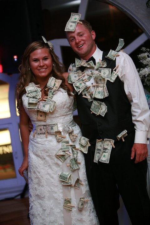Dollar dance....People pay to dance with the bride and groom and they get spending money for the honeymoon :)