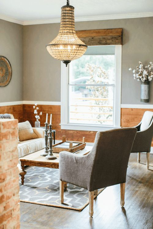 "Open but still clearly defined spaces. Neutral, warm, wood, black front door interior. Love the colors and materials used all throughout this house. Paint color throughout the house is Sherwin Williams ""Dovetail"".  Rustic transitional.  Magnolia Homes // Fixer Upper"