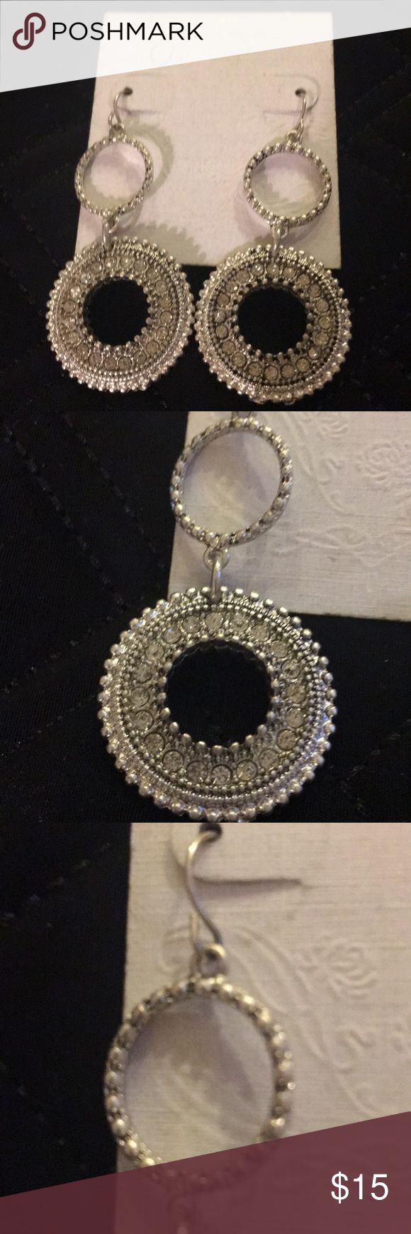 NWT Jessica Simpson Silver Rhinestone Earrings Jessica Simpson silver/rhinestone earrings. Small upper circles are silver metal and  have a circumference of 5/8 inches. The larger circles have a circumference of 1 inch and contain silver and glittery small rhinestones. Jessica Simpson Jewelry Earrings
