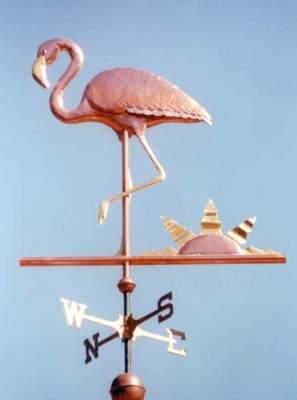 Flamingo Weather Vane, Standing by West Coast Weather Vanes.  The Flamingo weather vane featured in this photo has glass eyes were custom made for this weather vane.  They give it a very life like appearance!   We also offer many bird designs.