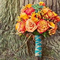 could do a bouquet with 2 colors and then material wrapped around could be the 3rd color