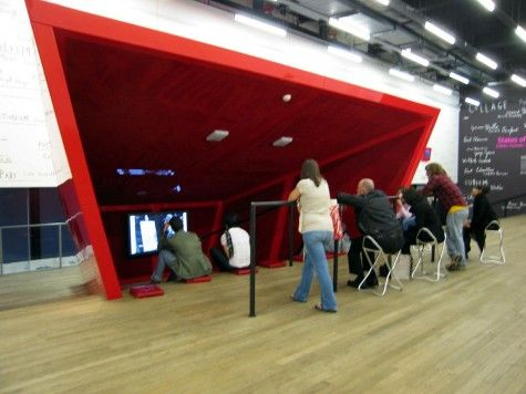 Tate Modern Level 5, a small theatre with in a red enclosure in the centre of the hall