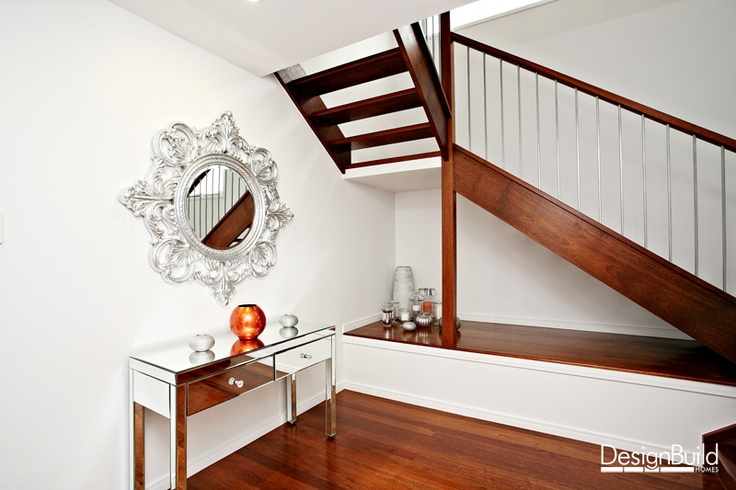 Niche under open tread staircase.