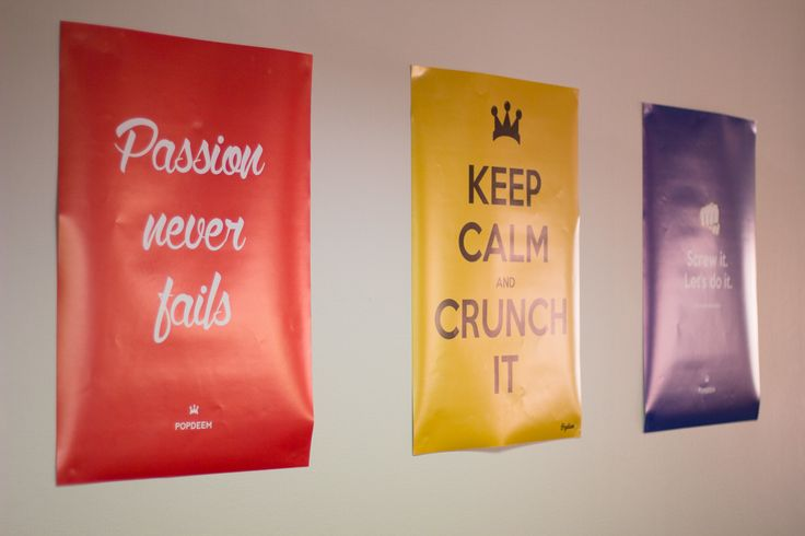 """Posters citing """"Passion Never Fails"""" and """"Screw it, Let's do it"""" represent the attitude within the company towards hard work, passion for your goals and taking calculated chances."""
