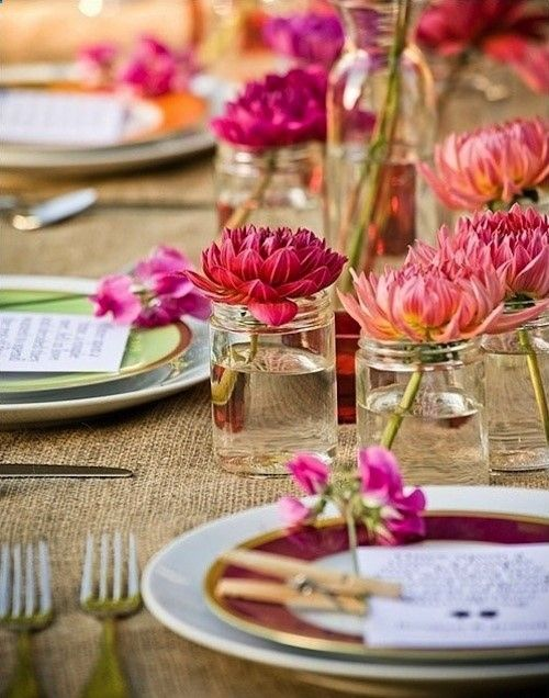 Burlap tablecloth helps to create a great tablescape for summer. Love the jars and fresh cut flowers