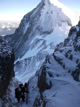 Lhotse Expedition Team in the gully on their summit day 2013 with Everest looming in the background. Photo Guy Cotter, Adventure Consultants
